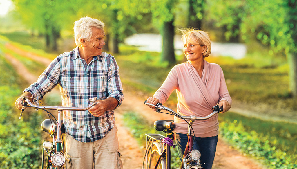 Couple wearing hearing aids living an active lifestyle